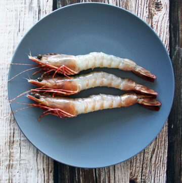 How to stop prawns curling when cooking