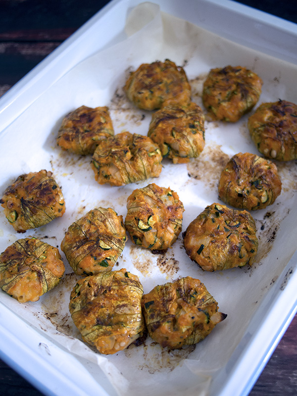 Zucchini Flower Fritters in a baking dish just out of the oven