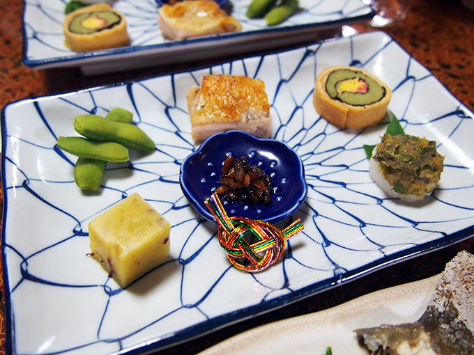 Tasting plate of local specialities, including wasp larvea