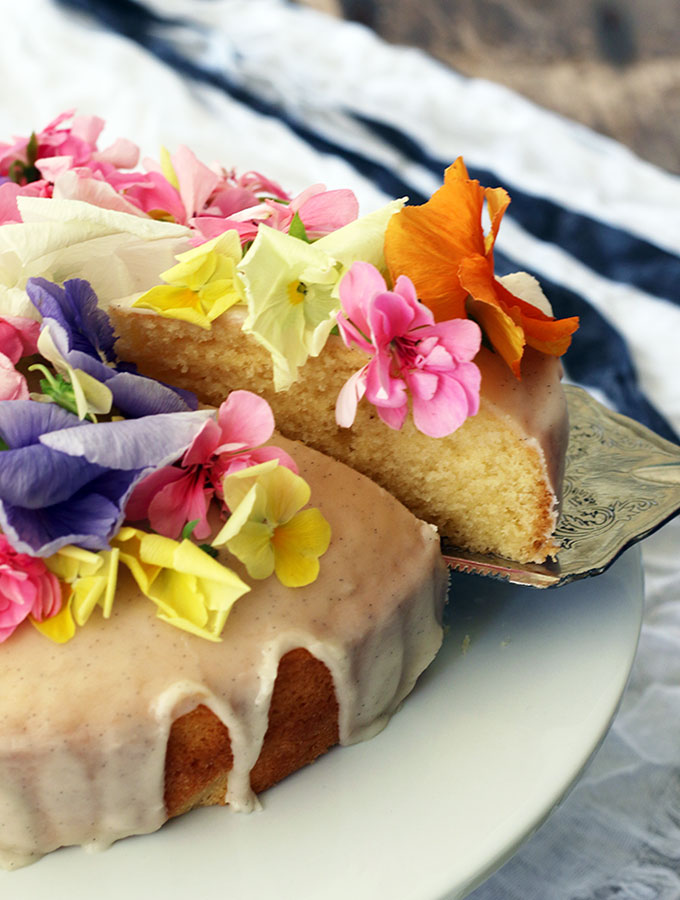 Brandy Butter Cake decorated with vanilla brandy icing and edible flowers