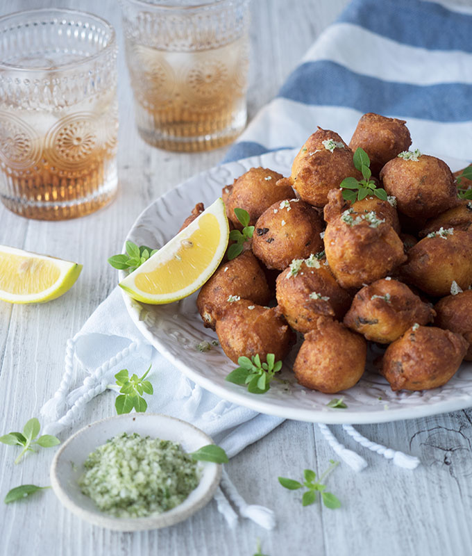 Cauliflower feta balls, sensational fried mouthfuls that you wont be able to stop popping. Served with lemon wedges and oregano salt.