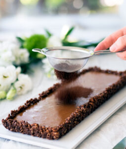 Caramel Chocolate Crackle Tart Recipe: Childhood party favourite is given a dose of adulthood with the addition of rich French Caramel to create the most decadent dessert.
