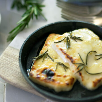 Grilled Halloumi with Honey and Rosemary - a simple dish to prepare and grill. The honey and rosemary enhances the halloumi brilliantly. This recipe is perfect with a crisp green salad.