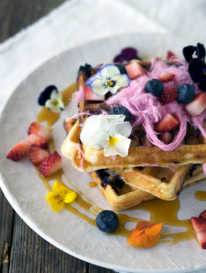 Blueberry White Chocolate Waffles, the pop of fresh blueberries and surprise of white chocolate make these waffles a breakfast winner.