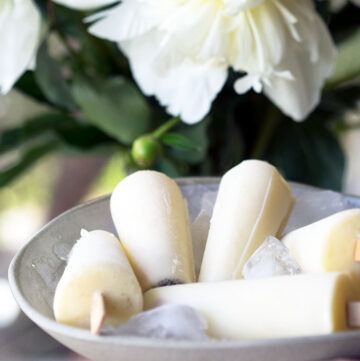 Vanilla Milk Ices are the lighter, easier alternative to making ice cream popsicles. Only three ingredients, no churning required and they are egg free.