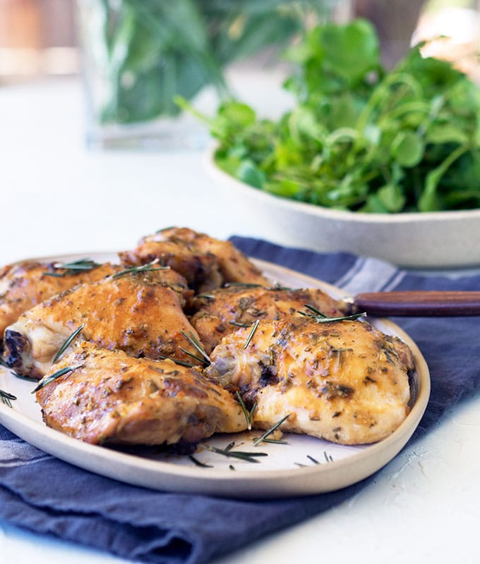 Simple to prepare oven baked skinless chicken thigh cutlets, with sticky maple, garlic and rosemary glaze. Simply Delicious mid week family fare.