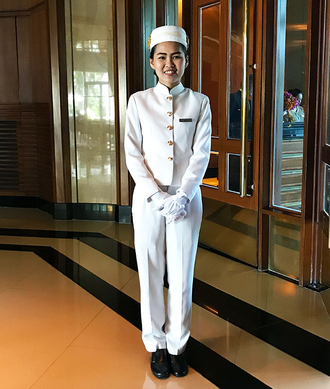 Door Person at the Peninsula Hotel Bangkok, the Peninsula Hotel Bangkok, The Peninsula Hotel Bangkok is a tranquil escape situated on the Chao Phraya River