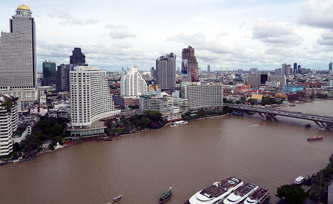 Sweeping views of the river from the Deluxe Suite of the Peninsula Hotel Bangkok