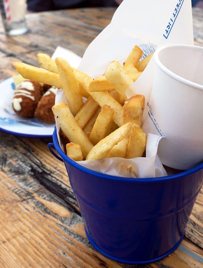 A bucket of chips at The Bucket List Bondi Beach, Dog Friendly Bar