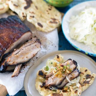 BBQ Smoked Pork Belly, Apple Fennel Slaw and Easy BBQ Flat Breads. Slow BBQ fall apart pork belly with zingy slaw and easy 3 ingredient flat breads.