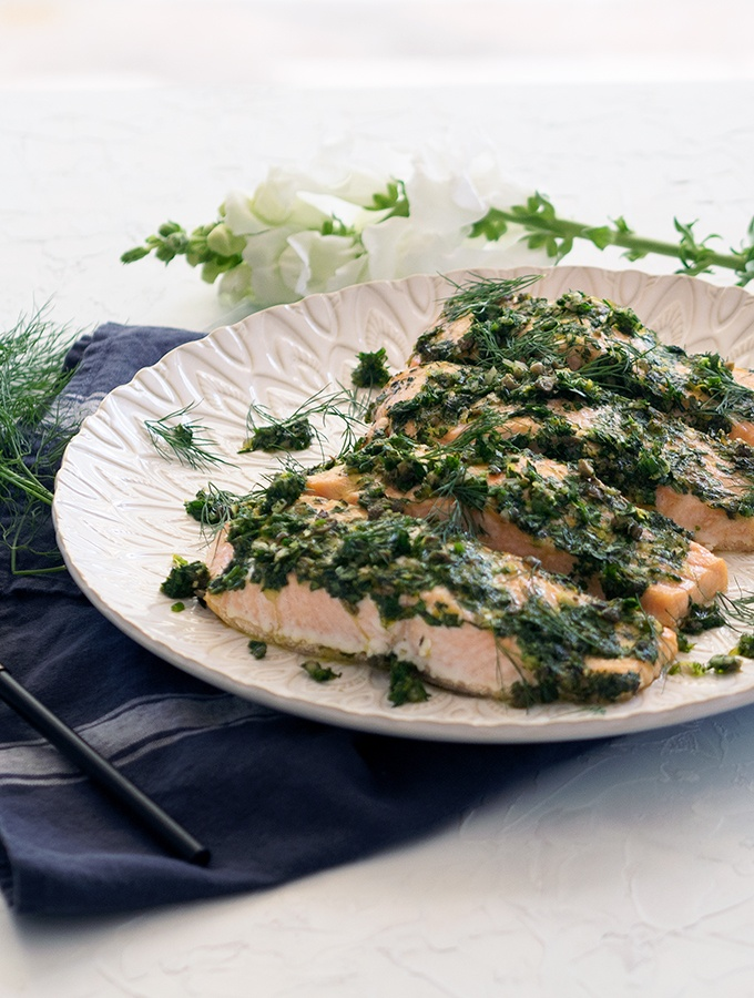 Juicy and tender oven baked salmon fillets. Flavour packed with fresh herbs, capers and lemon zest. Easy family meal recipe idea.