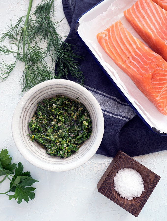 Fresh chive, dill and parsley dressing is perfect for quick and easy baked skinless salmon fillets. Healthy mid week meal on the table in 20 minutes.
