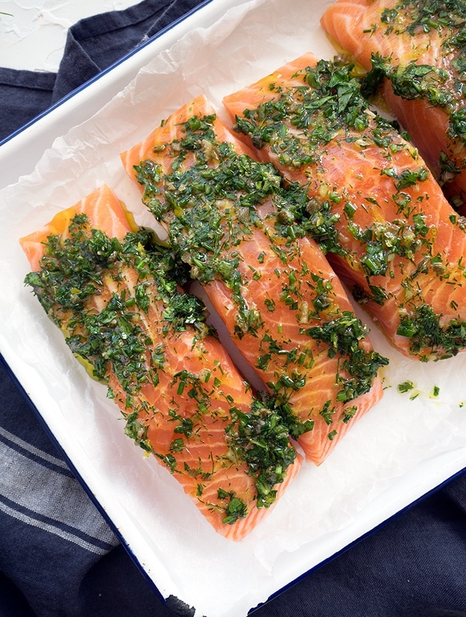 Oven baked salmon with dill, chives and parsley is a quick and easy mid week dinner recipe. Simply serve with salad or pan roasted potatoes.