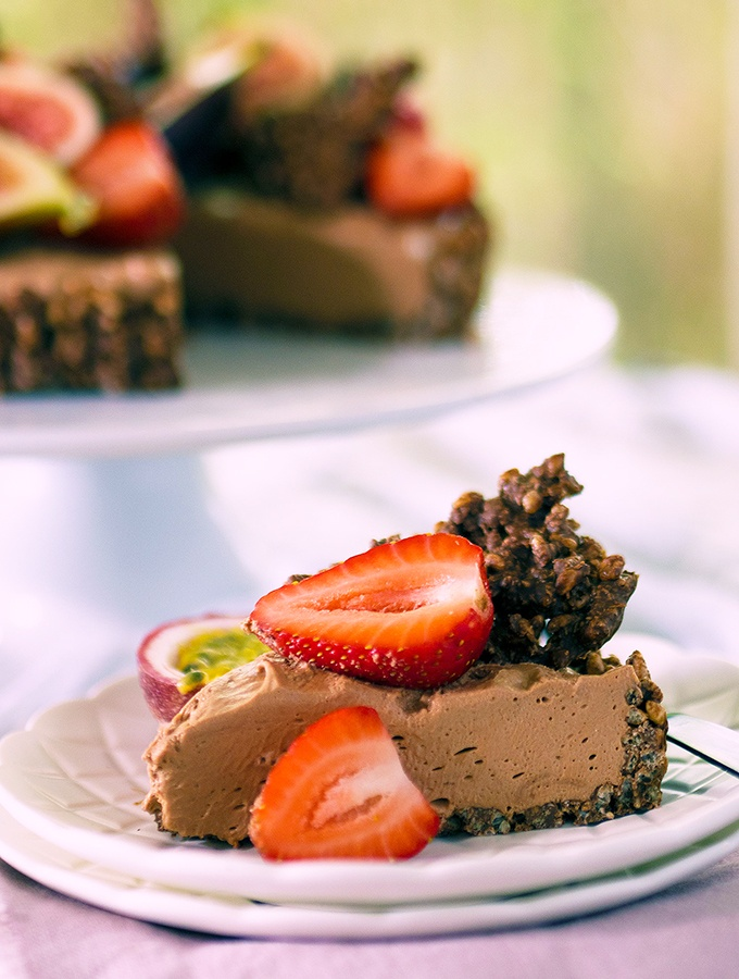 Chocolate cheesecake topped with lush berries, figs and passionfruit