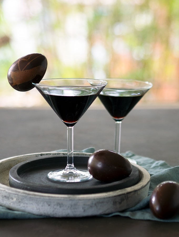 chocolatini cocktails in martini glasses with an easter egg as garnish