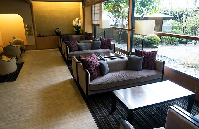 Guest lounge area overlooking the Japanese garden at Kozantei Ubuya Mt Fuji View Hotel Kawaguchiko Japan