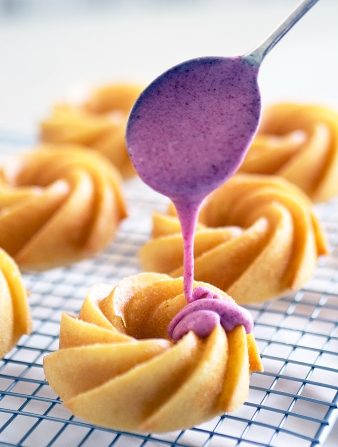Simple Melt and Mix Vanilla Cakes covered with freeze dried plum icing