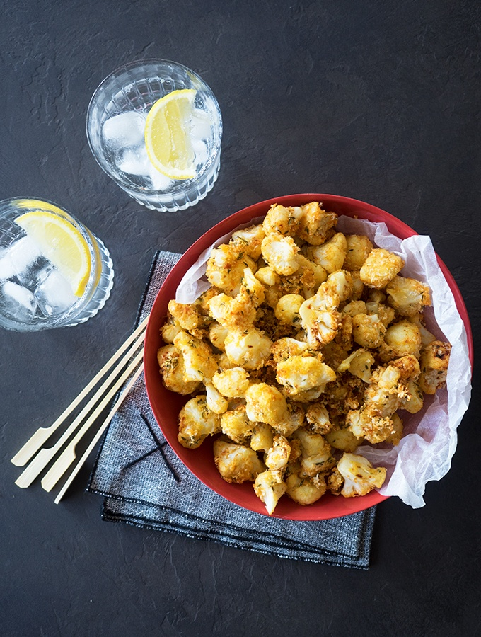 Oven Baked Popcorn Cauliflower made simply with breadcrumbs, parmesan cheese, thyme and smoked paprika