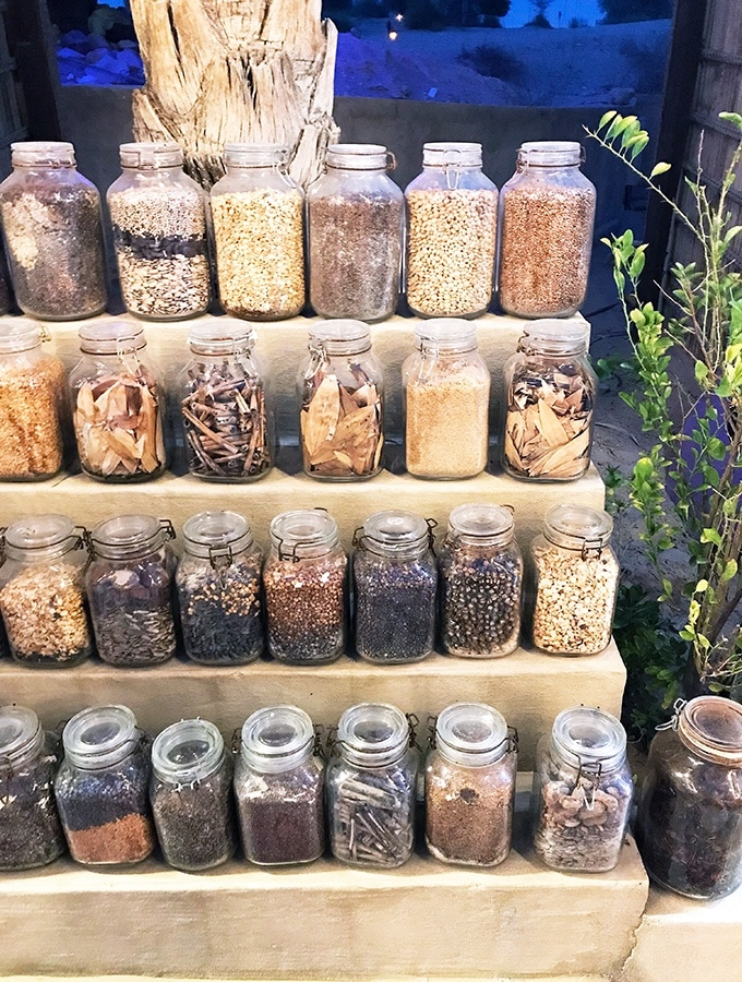 Jars of spices in the souk at Al Hadheerah Desert Restaurant Dubai