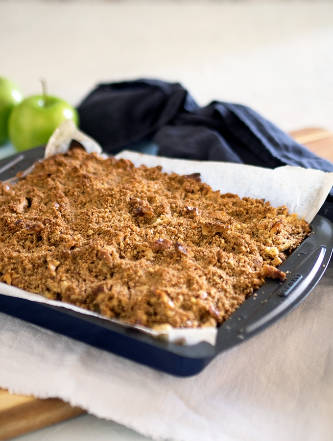 A slice filled with tasty stewed apples - Apple Walnut Crumble Slice