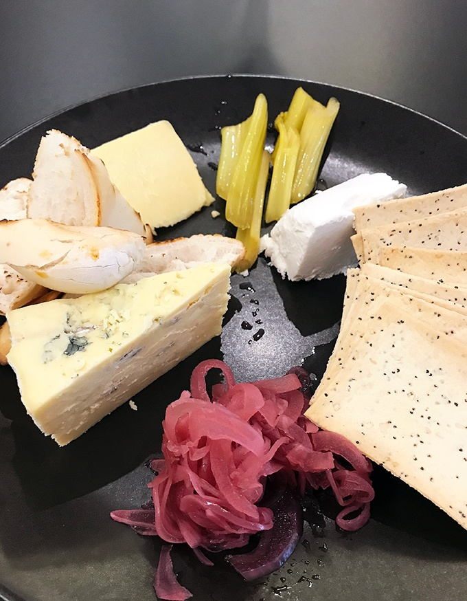 Cheese platter with amazing pickled celery, the best pickled vegetable in the world