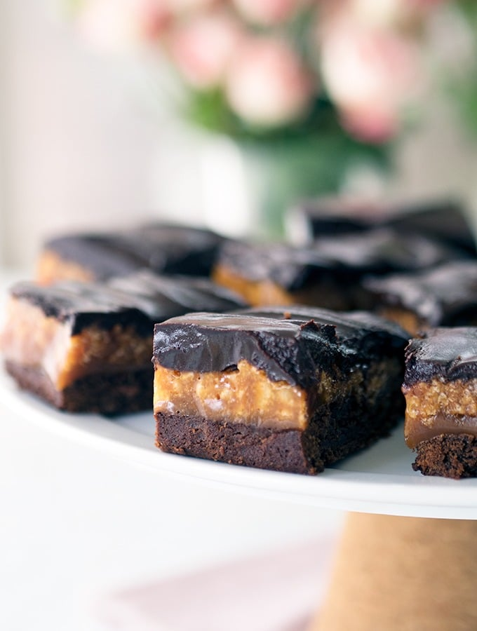Caramel Crunch Brownies - Simple dark chocolate ganache tops the caramel filling of these chocolate caramel brownies.