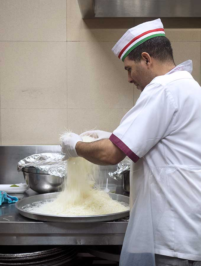 Chef preparing Kanafeh noodles