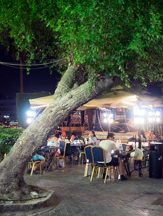 Outdoor seating in Dubai with a giant tree