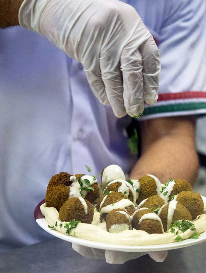 Chef preparing falafel in Dubai