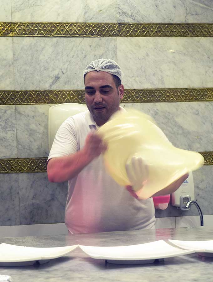 Chef tossing pastry for Egyptian Feteer in Dubai