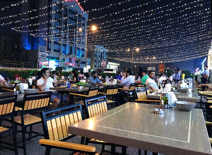 Fairy lights decorating outdoor seating at a Dubai Restaurant