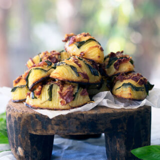 easy crispy hasselback potatoes stuffed with prosciutto and basil