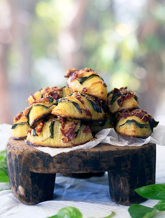 crispy hasselback potatoes stuffed with basil, prosciutto and parmesan