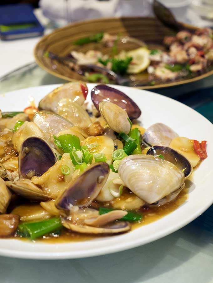Macanese cuisine wok fried pipis with xo chilli sauce and rice cake