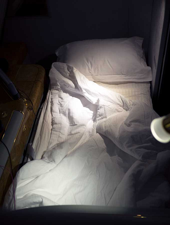Emirates First Class Sydney to Bangkok chair fully extended in first class suite as a fully flat bed