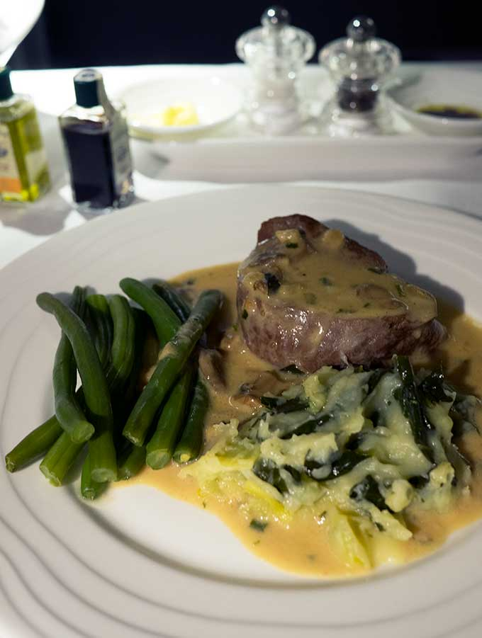 Emirates First Class Sydney to Bangkok eye fillet course with green beans