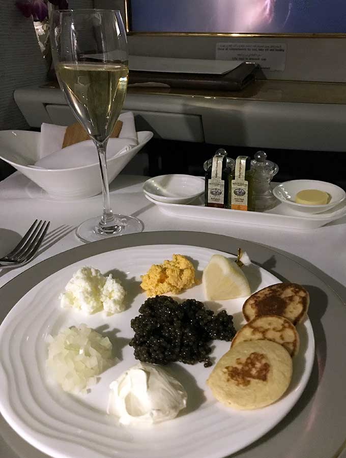 Emirates First Class Sydney to Bangkok caviar course with chopped egg yolk, chopped egg white, chopped onion and blinis
