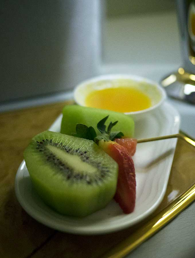 Emirates First Class Sydney to Bangkok post shower fruit plate