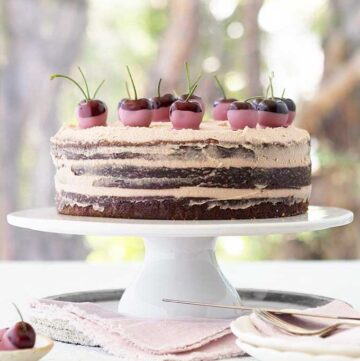 Three layer ruby chocolate mud cake with ruby chocolate gananche on a cake stand