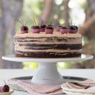 ruby chocolate mud cake, three layers with cherries on top