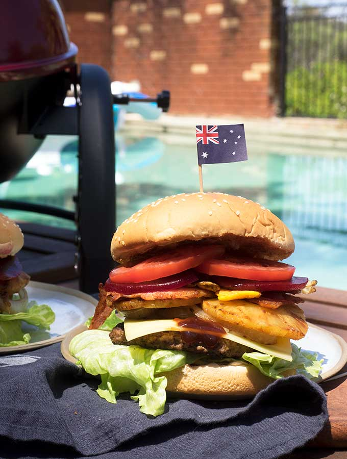 Aussie burger with the lot by the pool