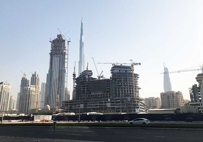 view of construction in dubai with burj khalifa in the back ground