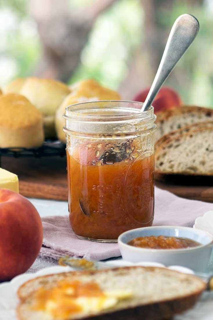 close up of an open jar of peach vanilla bourbon jam