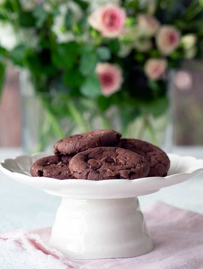 MKR Lyn & Sal's Brownie Cookies sitting on a plate in front of some flowers