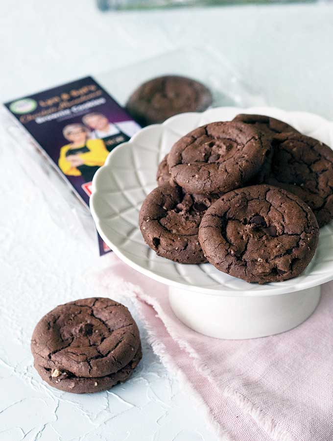 MKR Lyn & Sal's Brownie Cookies sitting on a plate with the packet in the back ground