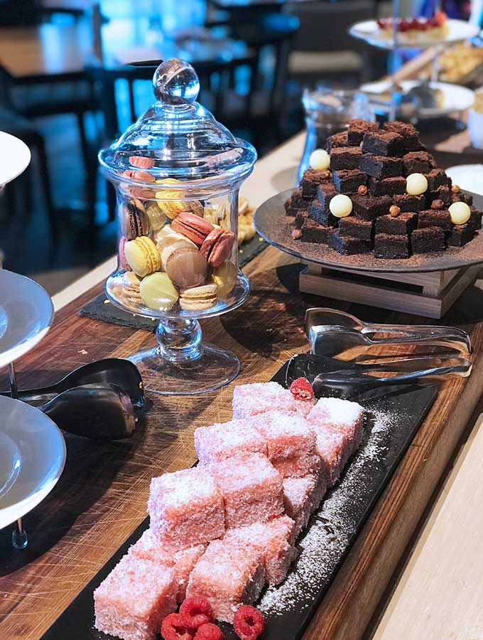 pink lamingtons on a dessert buffet