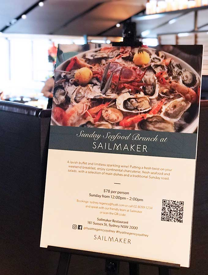 sign with information regarding seafood sunday brunch