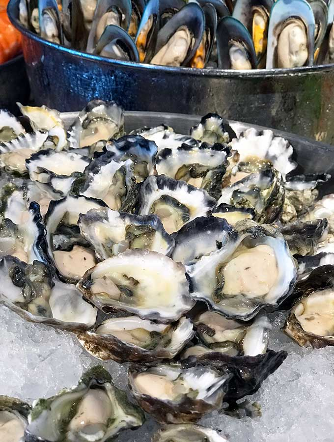open oysters in a bowl filled with ice