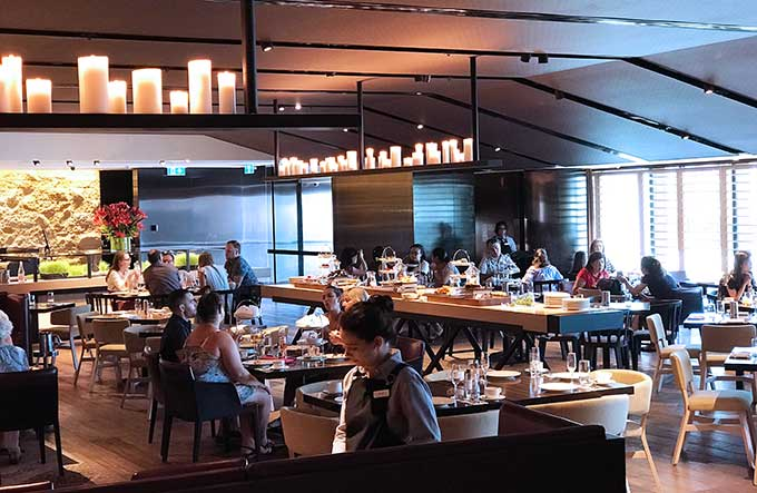 tables, chairs and patrons at Sailmaker Hyatt Regency Sydney