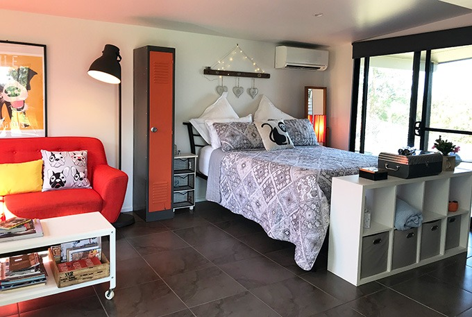 double bed in open plan room at the dog house port macquarie